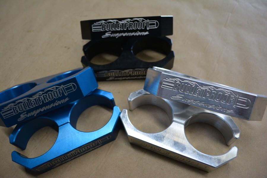 billet shock clamps